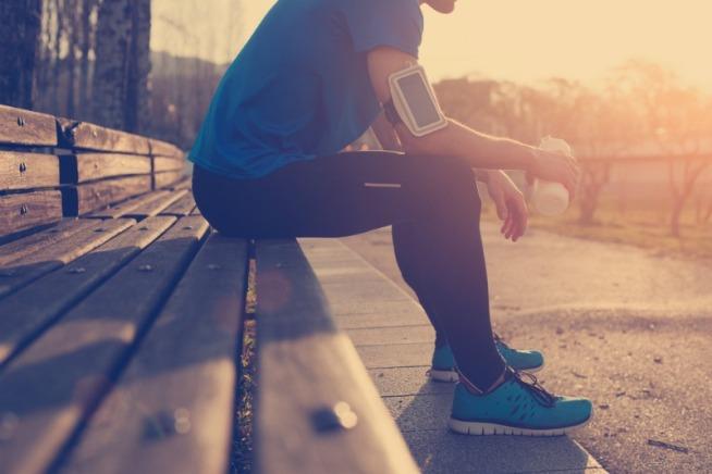 athlete-sitting-on-bench